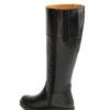 botas negras altas piel caña ancha piso de goma